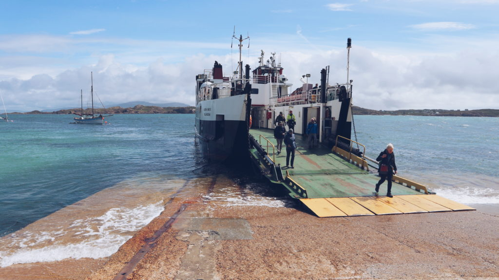 Passengers walking off the ferry boat at the port at Iona.