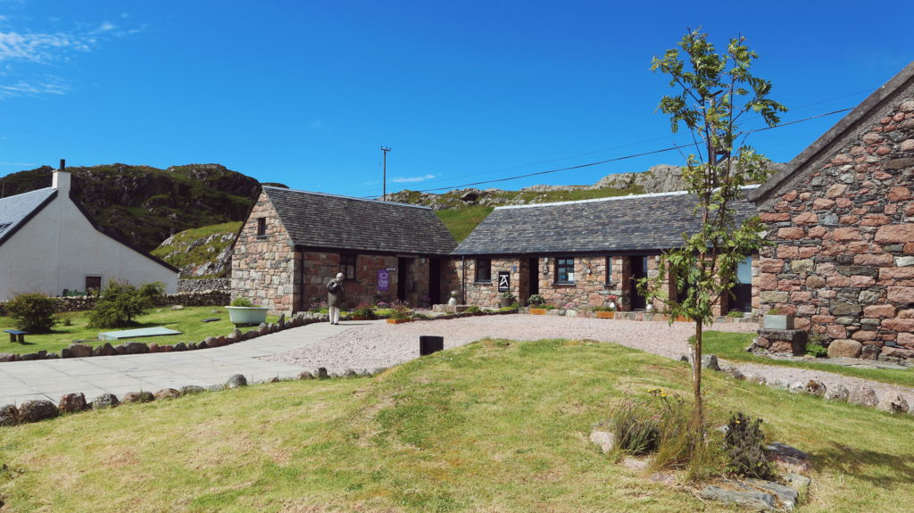 Stone cottages with a bright blue sky